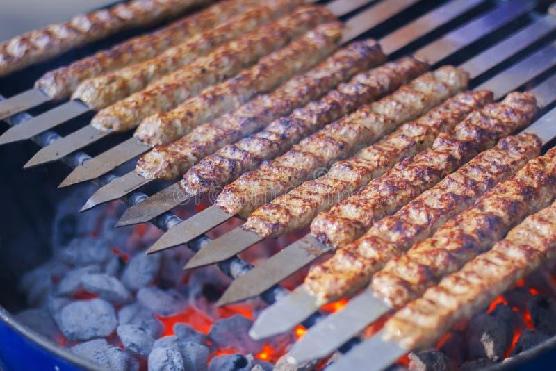 Rows of juicy beef kebab stock photo