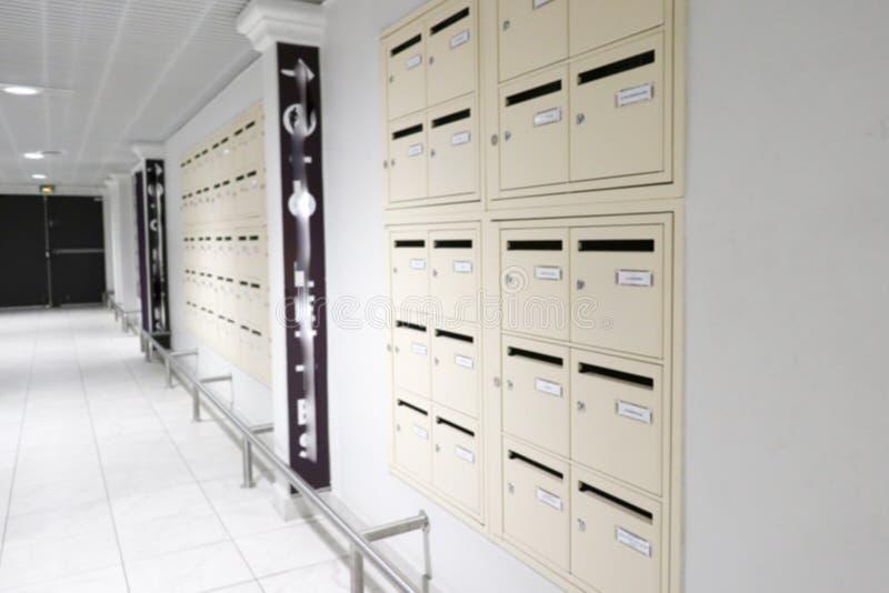 Rows of locked metal apartment or condominium mailboxes stock photo