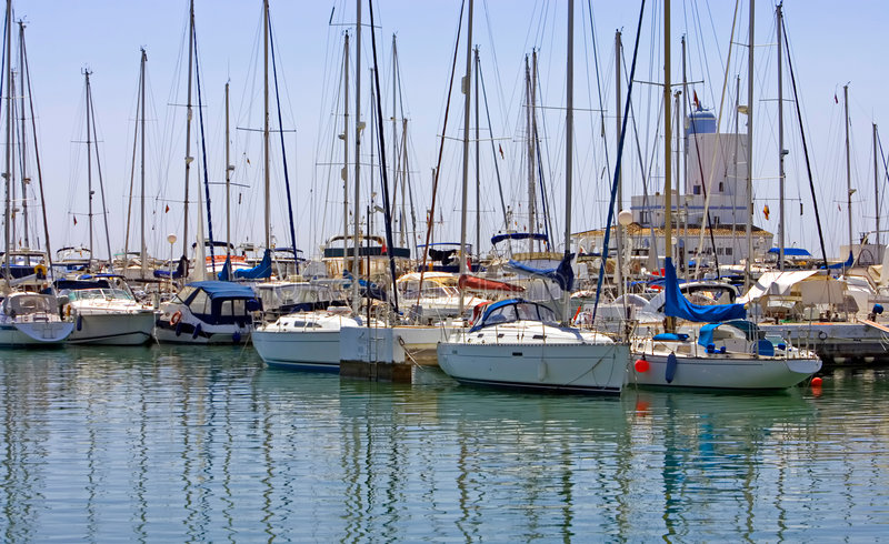 Rows of luxury yachts in Duquesa port in Spain on the Costa del stock photos