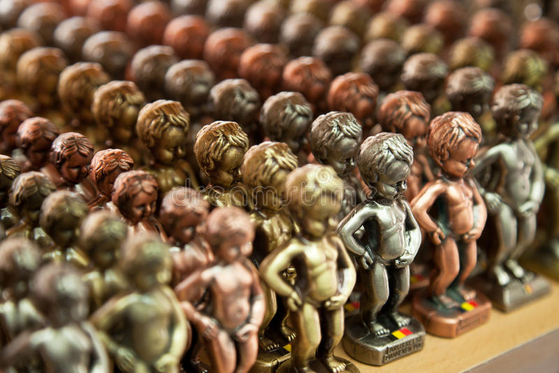 Rows of Manneken Pis Metallic Replicas in different Colors. Large number of small metallic replicas of Manneken Pis statue arranged in rows to be sold as a stock images