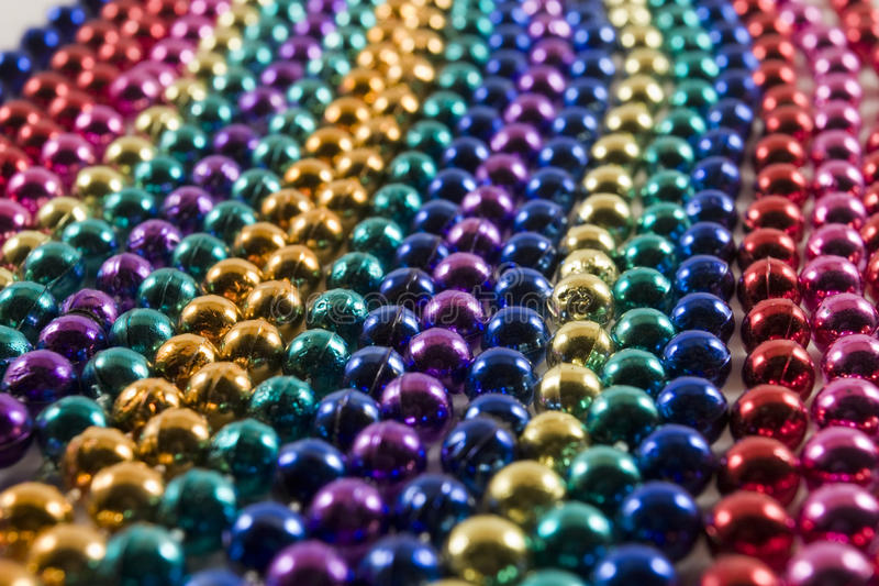 Rows of Mardi Gras beads. Rows of multi colored Mardi Gras beads stock images