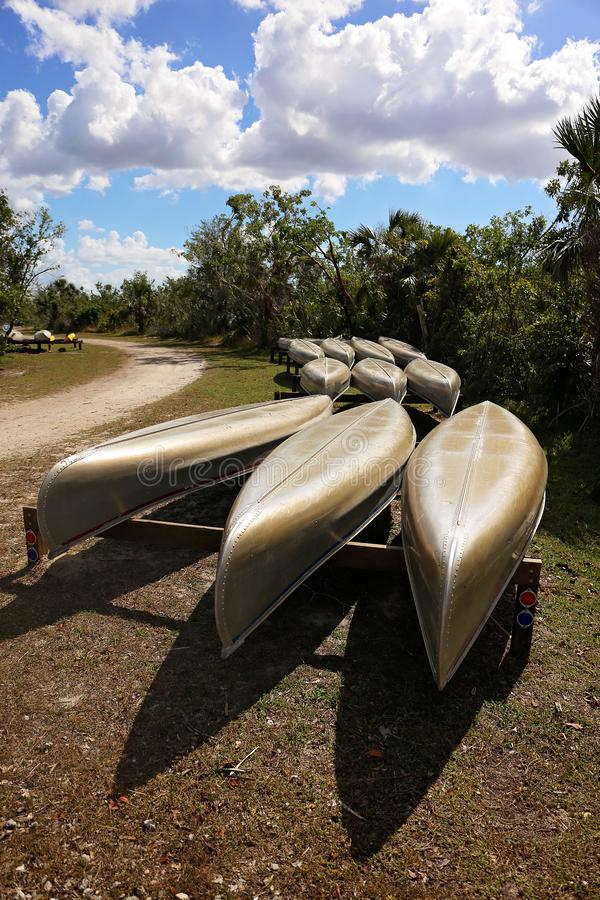 Rows of Metal Rental Canoes on Boat Racks in the Florida Everglades royalty free stock images