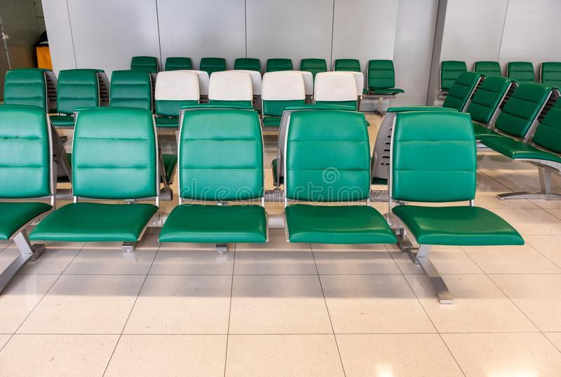 Rows of modern green chairs in waiting room royalty free stock photos