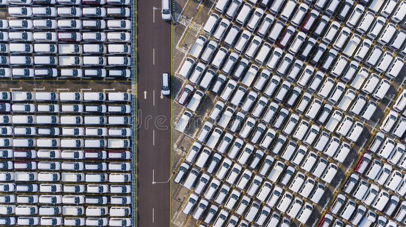 Rows of new cars parked at the port stock photos