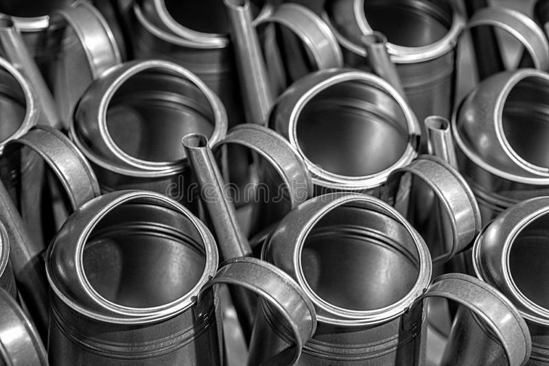 Rows of new metal garden watering can, soft focus, film grain - image royalty free stock photo