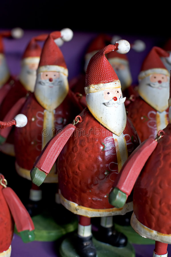 Free Rows Of Funny Santas For Sale On A Shelf Stock Photos - 365453