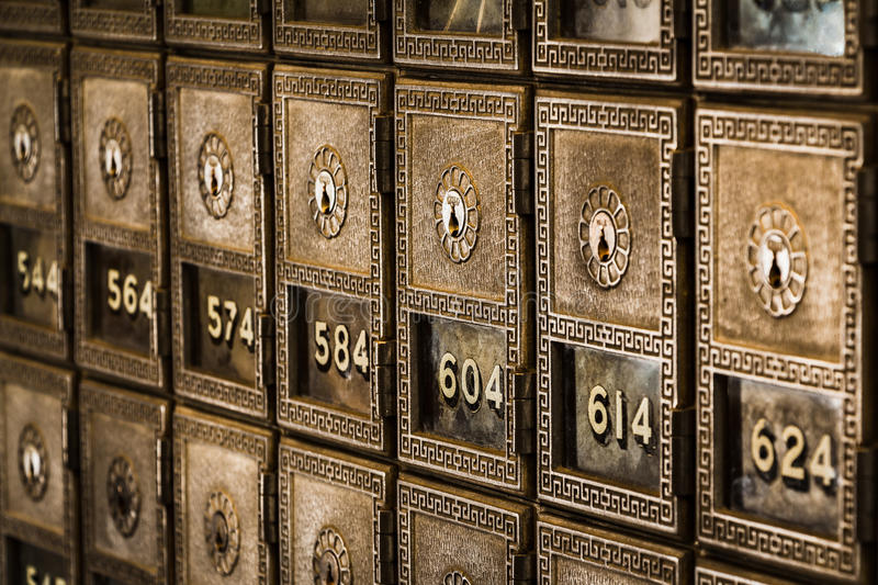 Rows of Old-Fashioned Post Office Boxes royalty free stock images