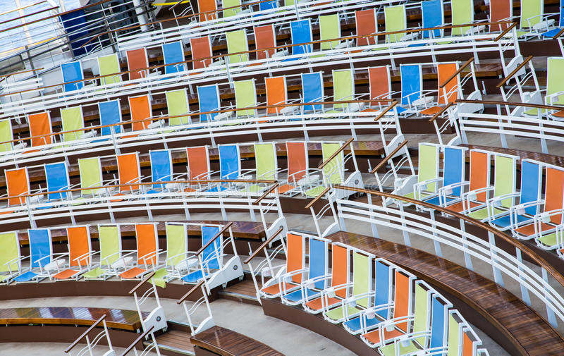 Download Rows Of Orange Blue And Yellow Chairs Stock Photo - Image: 43200456
