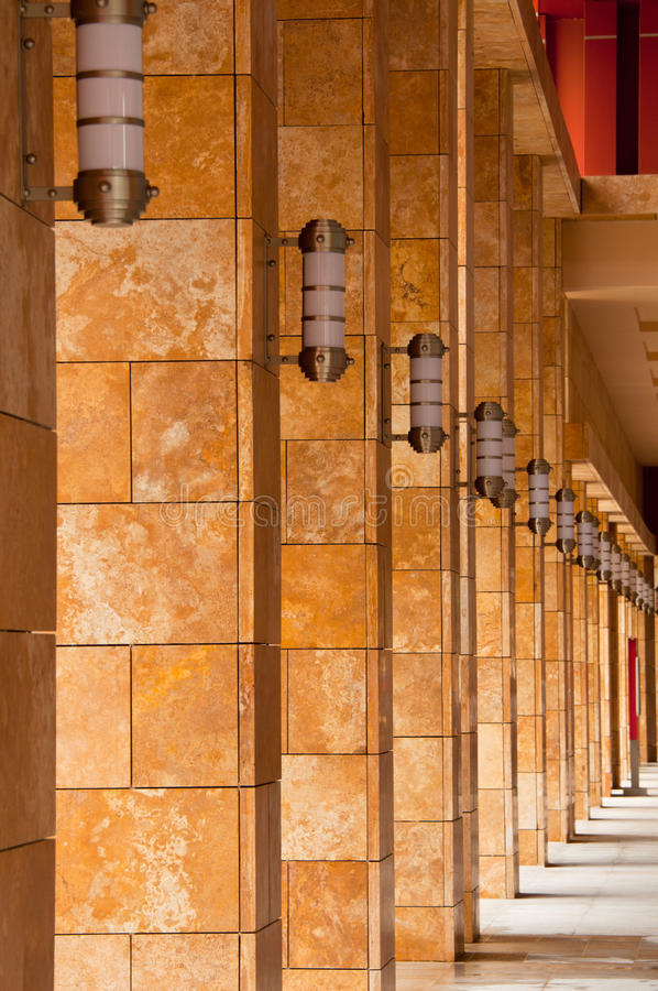 Rows of Pillars. A portrait rows of marble pillars with installed decorative lighting stock photography