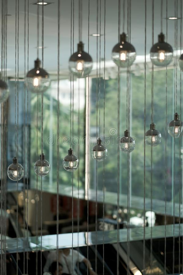 Rows of round decorative lights suspended from the ceiling stock photos