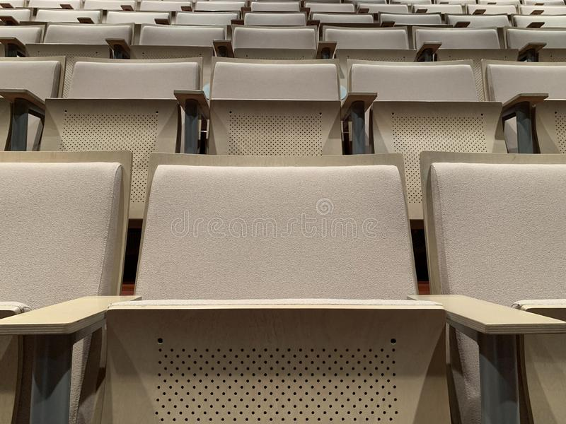 Rows of seats in an empty theater stock images
