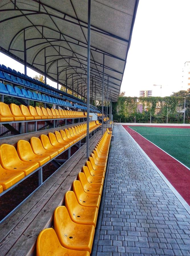 Rows of seats on the sports field. At which different competitions take place royalty free stock photo