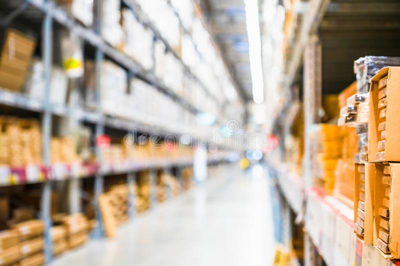 Rows of shelves with goods boxes in modern industry warehouse store at factory warehouse storage, Shelves and racks in royalty free stock photos