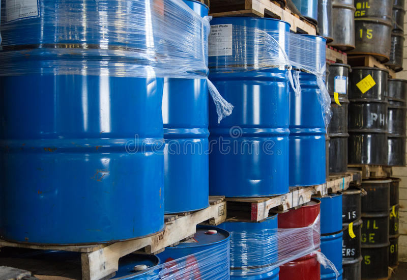 Rows of stacked oil barrels. Rows of old, used stacked oil barrels stock images