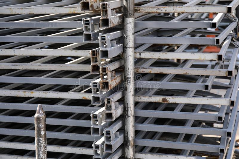 Rows of steel bar storage and stacking in the warehouse for industrial construction stock images