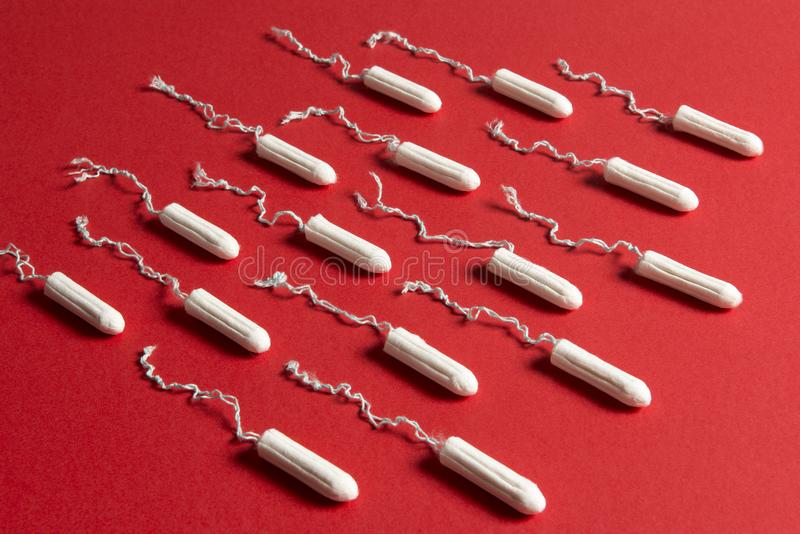Rows of Tampons on a Red Background stock image