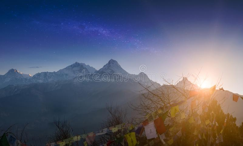 Rows of Tibetan prayer flags at Annapurna Base Camp road. Trekking in Himalaya mountains, Nepal. Nature landscape royalty free stock images