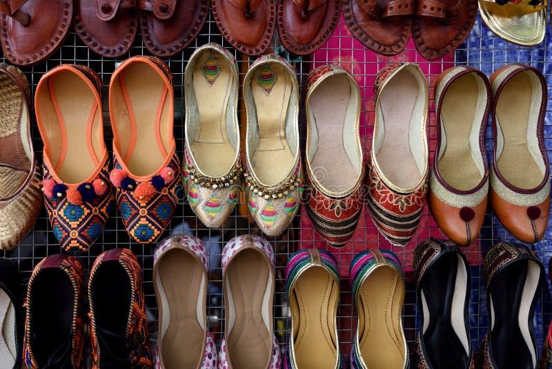 Rows of traditional ethnic handmade Rajasthani ladies footwear stock photos