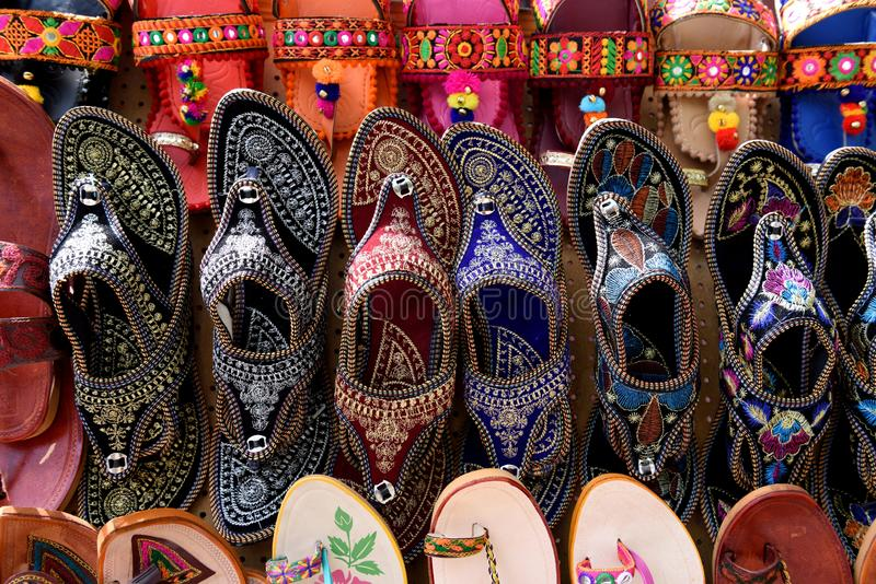 Rows of traditional handmade Rajasthani women`s sandals royalty free stock photos