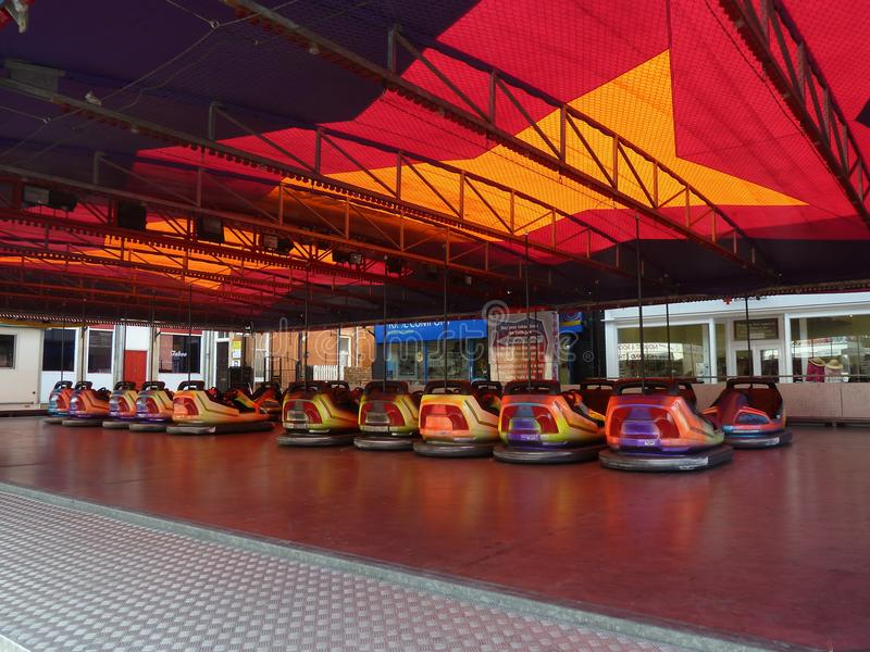 Rows of empty funfair bumper cars stock photography
