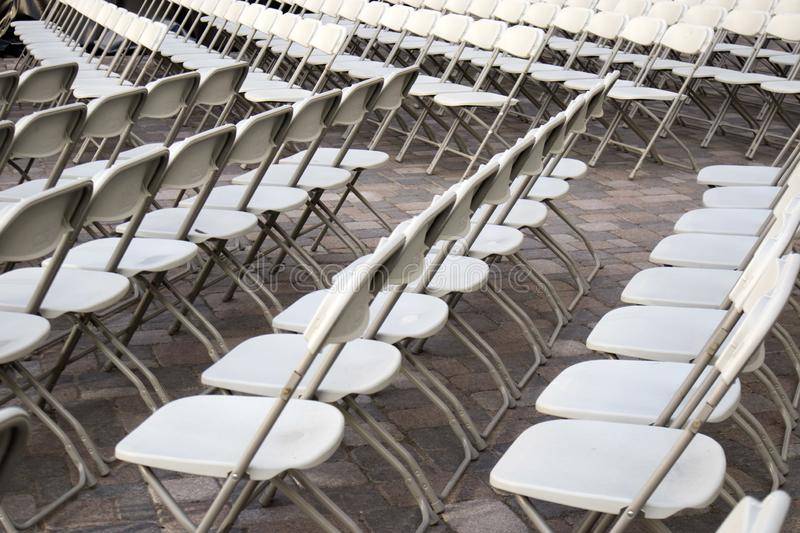 Rows of white chairs frontview outside for cinema royalty free stock images