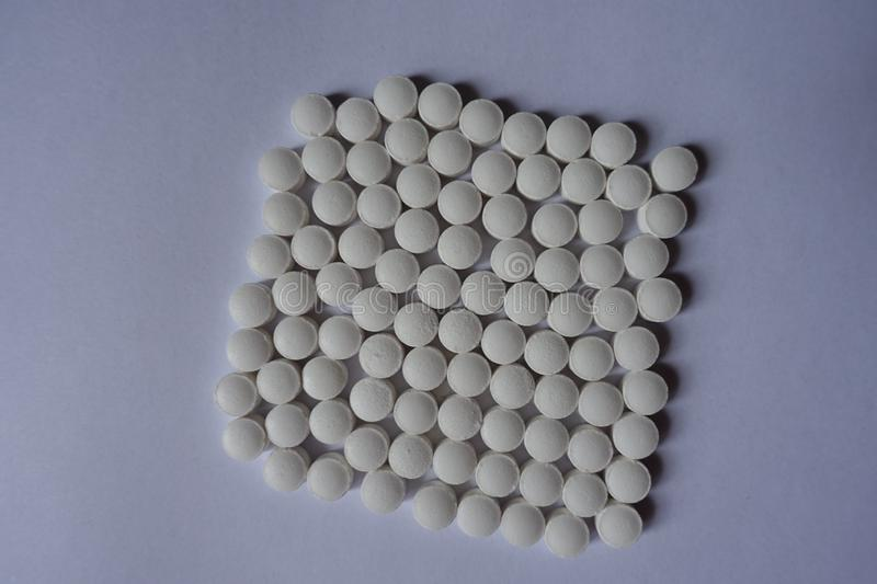 Rows of white tablets of vitamin K2 stock photo