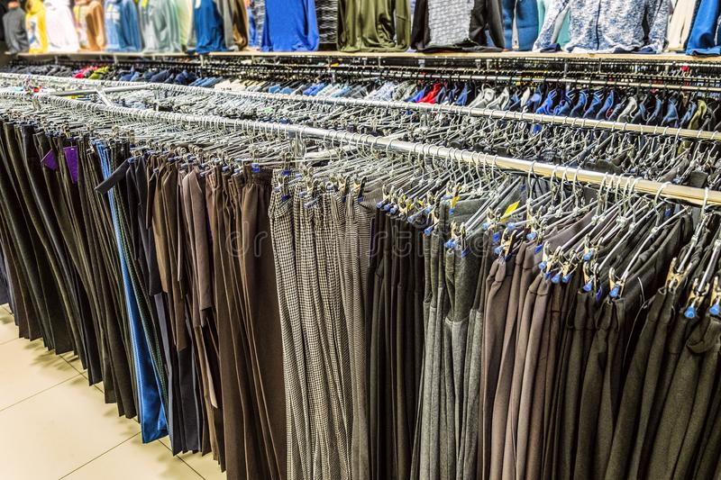 Rows of women trousers hanging on trempels stock photography