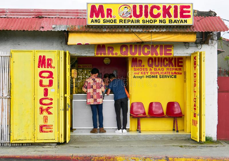Mr. Quickie shoe and bag repair and key duplicate shop royalty free stock image