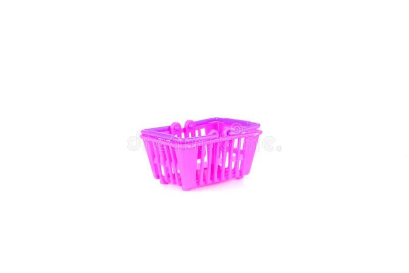 Roxo e cesta ou carrinho de compras cor-de-rosa do brinquedo isolados no fundo branco fotos de stock
