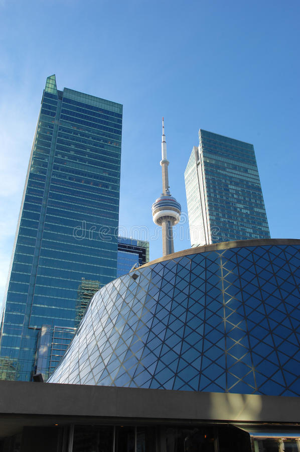 Roy Thomson hall and CN tower. Downtown Toronto with the Roy Thomson hall, the CN tower and two tall high rise buildings royalty free stock photos