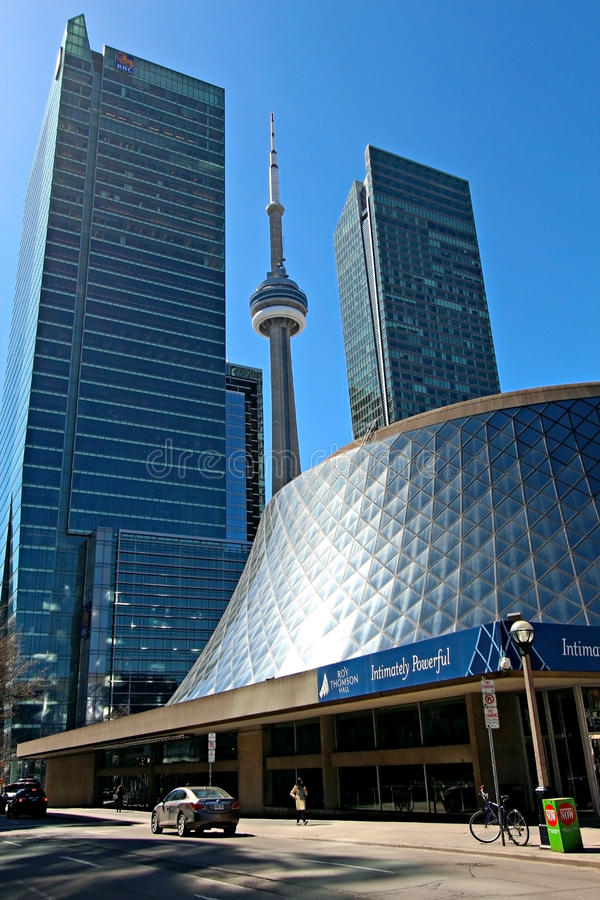 Roy Thomson Hall and CN Tower. TORONTO - APRIL 17: The Roy Thomson Hall in downtown Toronto on April 17 2013. One of Canada's premier concert venues since royalty free stock photos
