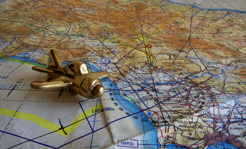 Royal Air Force flight map and brass aeroplane paperweight. A Royal Air Force flight map, showing a section of the Italian coast, north from Napoli and a small royalty free stock images