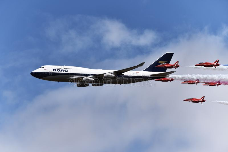 Red Arrows with a BA 747 royalty free stock image