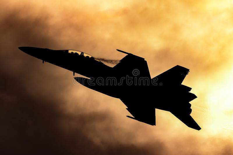 Royal Australian Air Force RAAF Boeing F/A-18F Super Hornet multirole fighter aircraft silhouetted against a sunset. Avalon, Australia - February 26, 2013 stock photos