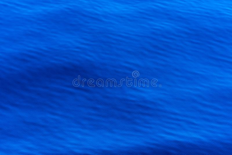 Royal blue sea background with a regular fine wave structure, wallpaper, abstract pattern, background. Calm sea, photo taken near Albania stock image