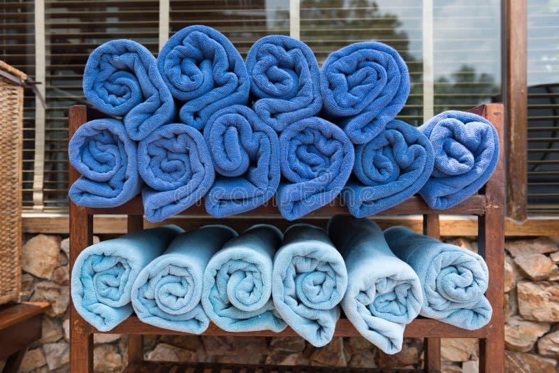 Royal blue towel on wooden shelves.  stock photos