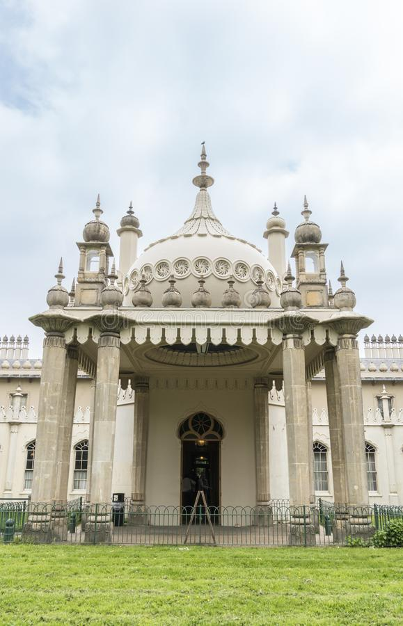 Royal Brighton Pavilion, UK. The Royal Pavilion in Brighton, East Sussex, UK, with a couple taking a selfie in the foreground stock image