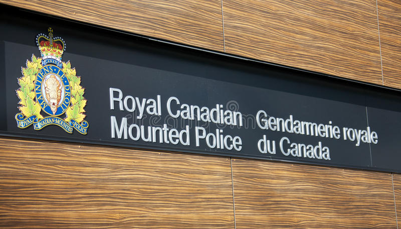 Royal Canadian Mounted Police. VANCOUVER, CANADA - JANUARY 26, 2015: Sign for the Royal Canadian Mounted Police, RCMP, in both English and French stock photo