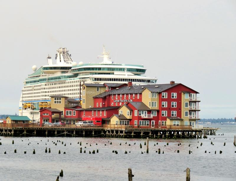 Astoria, Oregon, 9/16/2018, Royal Caribbean`s Explorer of the Seas cruise ship docked along side the Cannery Pier Hotel & Spa. Royal Caribbean`s Explorer of the royalty free stock images