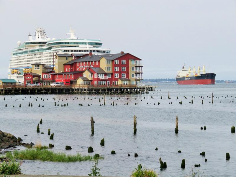 Astoria, Oregon, 9/16/2018, Royal Caribbean`s Explorer of the Seas cruise ship docked along side the Cannery Pier Hotel & Spa stock photos