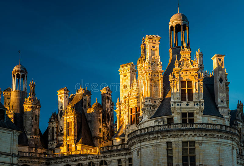 The royal castle Chateau de Chambord at sunset, France stock photos