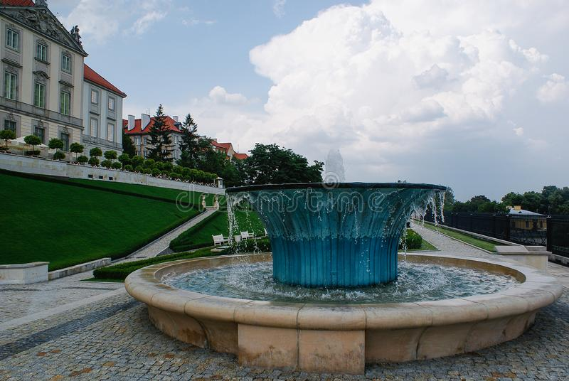 Royal Castle in Warsaw, Poland. The back entrance from the Vistula river to the Royal Castle in Warsaw. Waterfountain in the garden stock photography