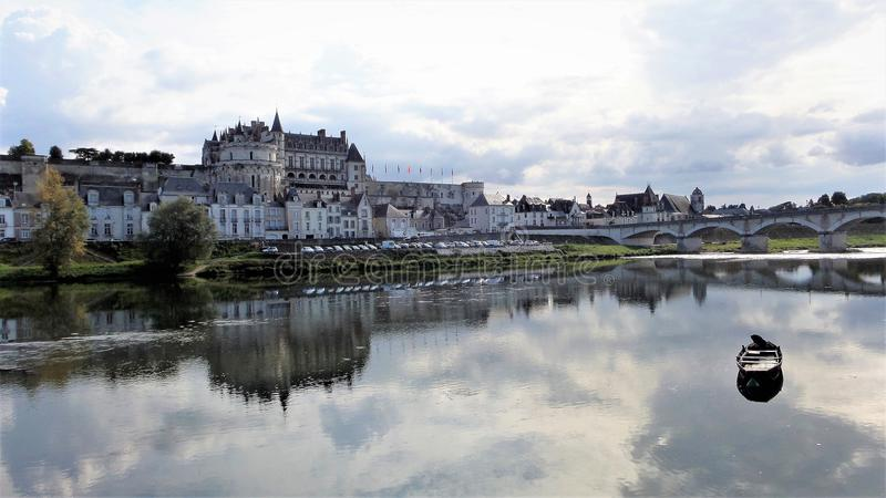 The royal Château at Amboise. Boat on the water surface. royalty free stock photo