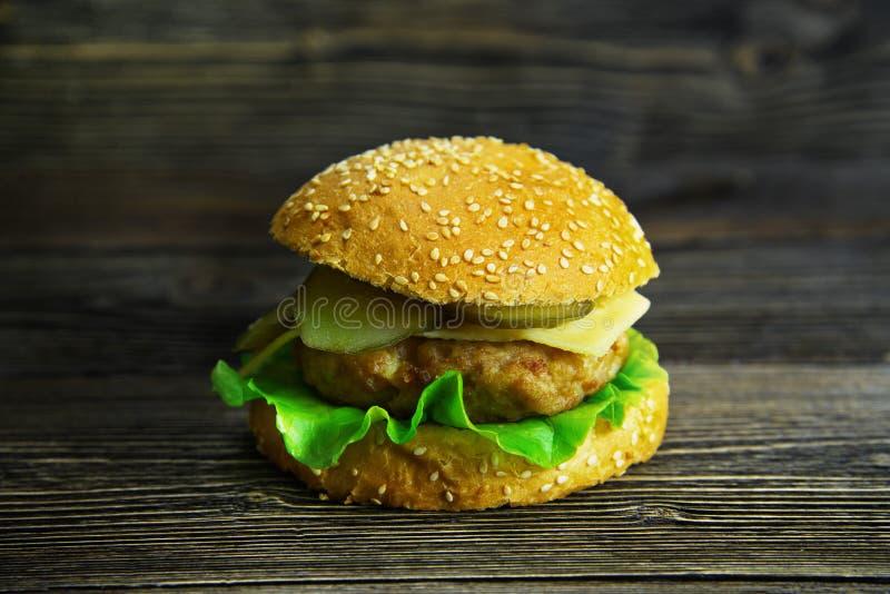 Royal cheeseburger with salad stock image