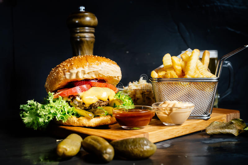 Royal cheeseburger, tasty and delicious beef burger served by local restaurant. royalty free stock photo