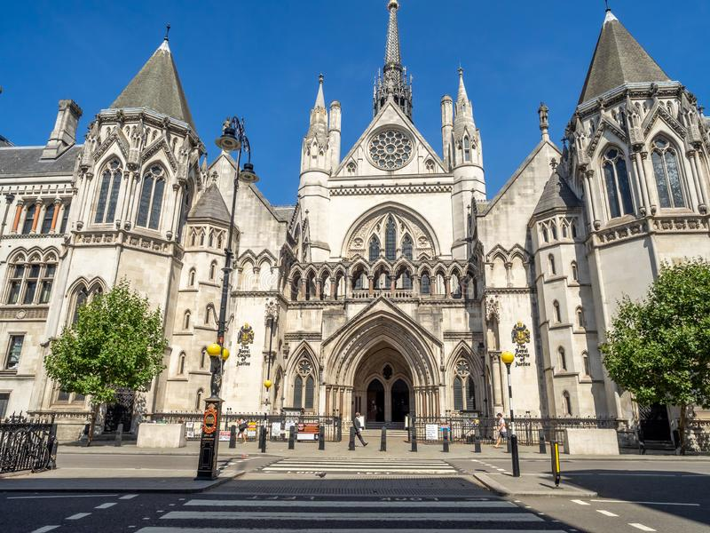 Royal Courts of Justice in London England. London, England - August 6, 2018: Historical building and entrance of Royal Courts of Justice in London England stock image