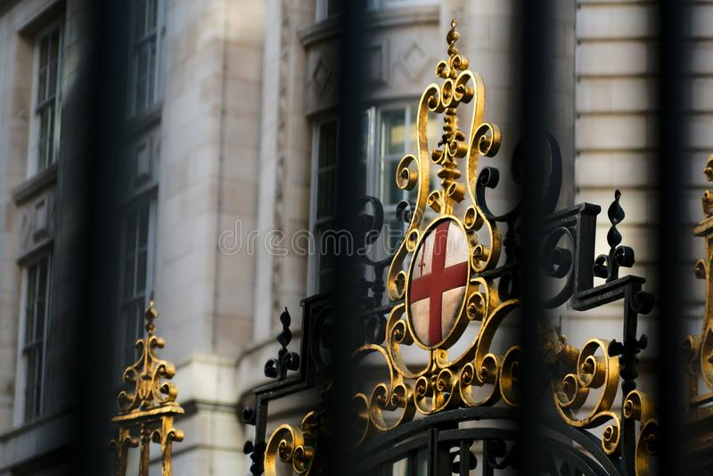 Royal crest in the streets of London royalty free stock image