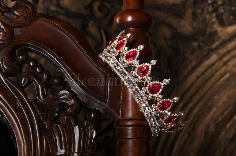 Royal crown with red gems. Ruby, garnet. Symbol of power and authority stock image