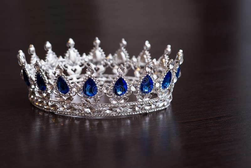 Royal crown with sapphires. Wealth symbol of power and success royalty free stock image