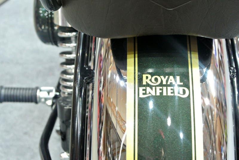 ROYAL ENFIELD motorcycle brand and logos at the motorcycle body. KUALA LUMPUR, MALAYSIA -MARCH 31, 2018: ROYAL ENFIELD motorcycle brand and logos at the stock photo